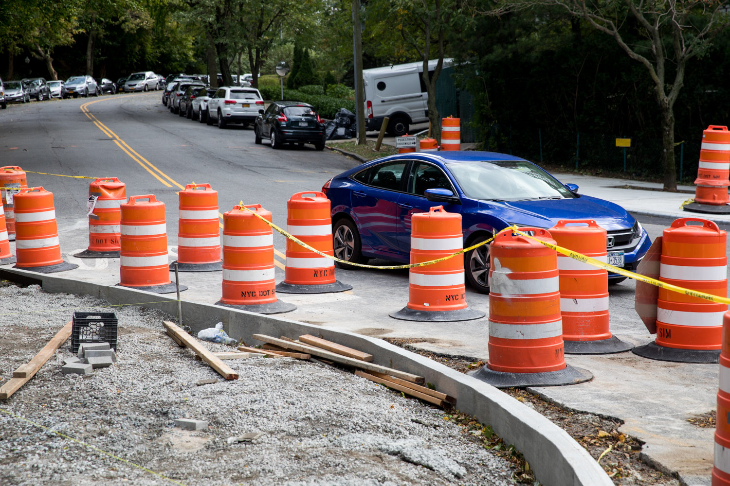 A car waits to turn onto Palisade Avenue from Kappock Street near a curb extension. The city's transportation department is in the process of extending the curbs in an effort to make the intersection safer for pedestrians.