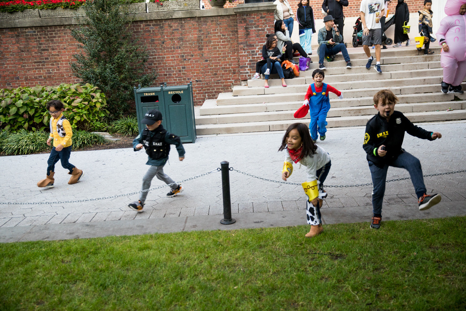 Costumed children race across the Manhattan College quad for the school's annual Safe Halloween event on Oct. 25.