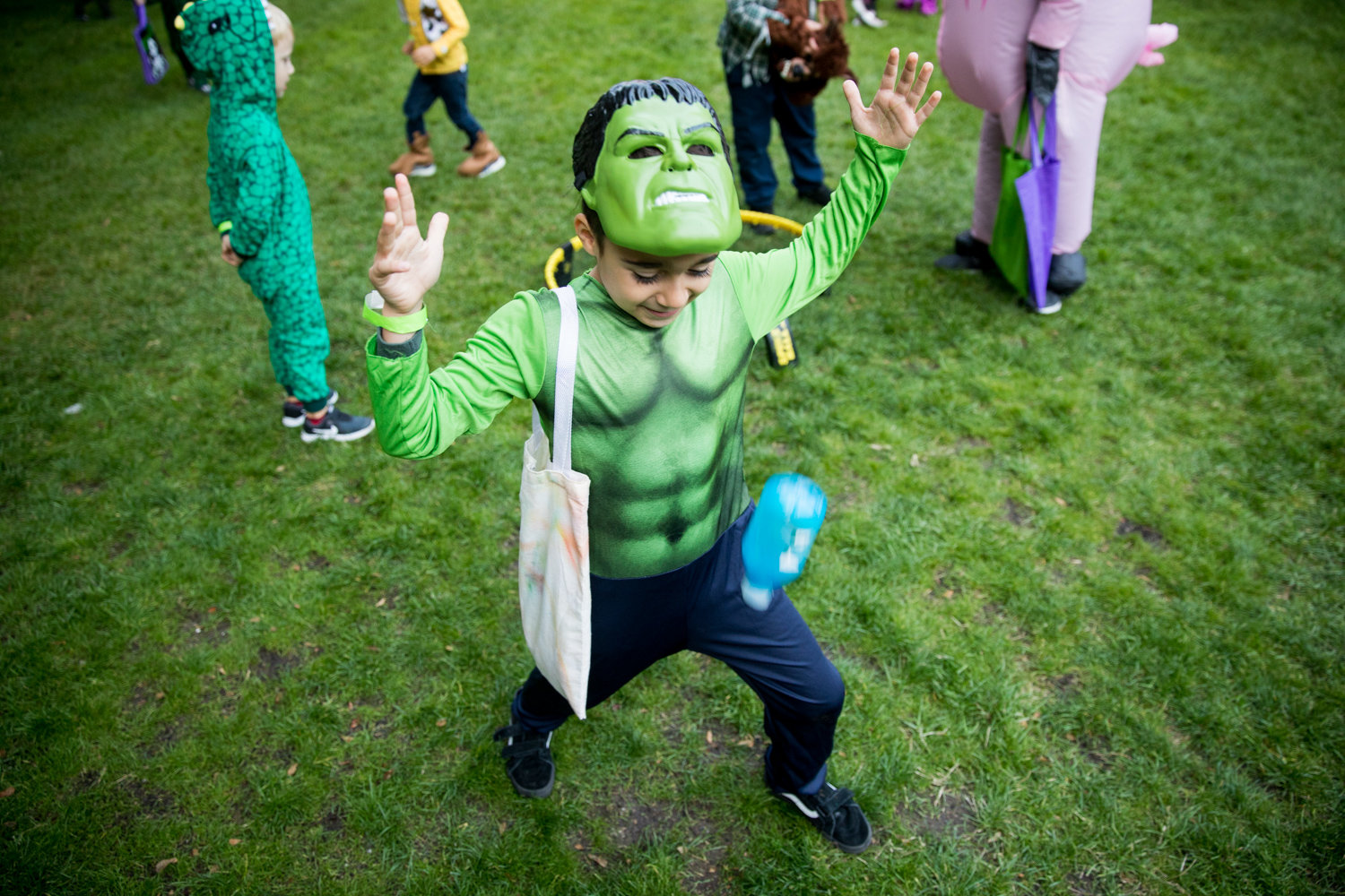 A miniature Incredible Hulk flips a bottle to see if it will land right side up during Manhattan College's Safe Halloween event on Oct. 25.