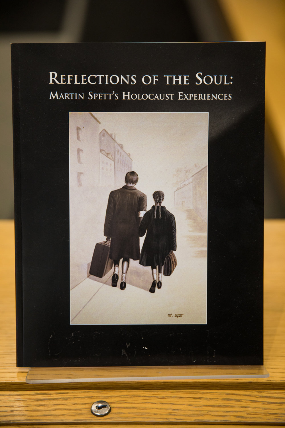 Martin Spett painted an image of him with sister Roslyn carrying suitcases leaving Tarnow, Poland, that adorns the cover of a book about his experience during the Holocaust. Spett died Oct. 20. He was 90.