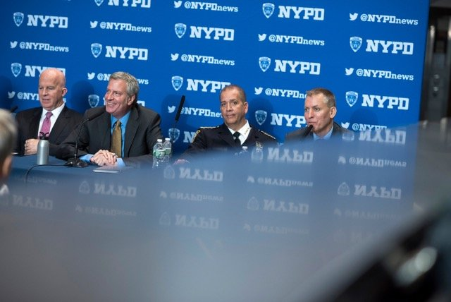 New York Police Department chief of crime controls strategies Dermot Shea, right, speaks about crime statistics alongside Mayor Bill de Blasio and Commissioner James O'Neill in 2017. Shea — who commanded the 50th Precinct in 2006 — is now the new NYPD commissioner, succeeding O'Neill on Dec. 1.