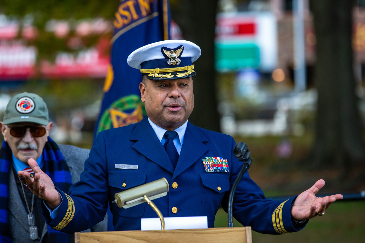 U.S. Coast Guard Reserve Cmdr. Sergio Villaverde speaks about the importance of community for veterans during a ceremony in Van Cortlandt Park's Memorial Grove on Nov. 3.