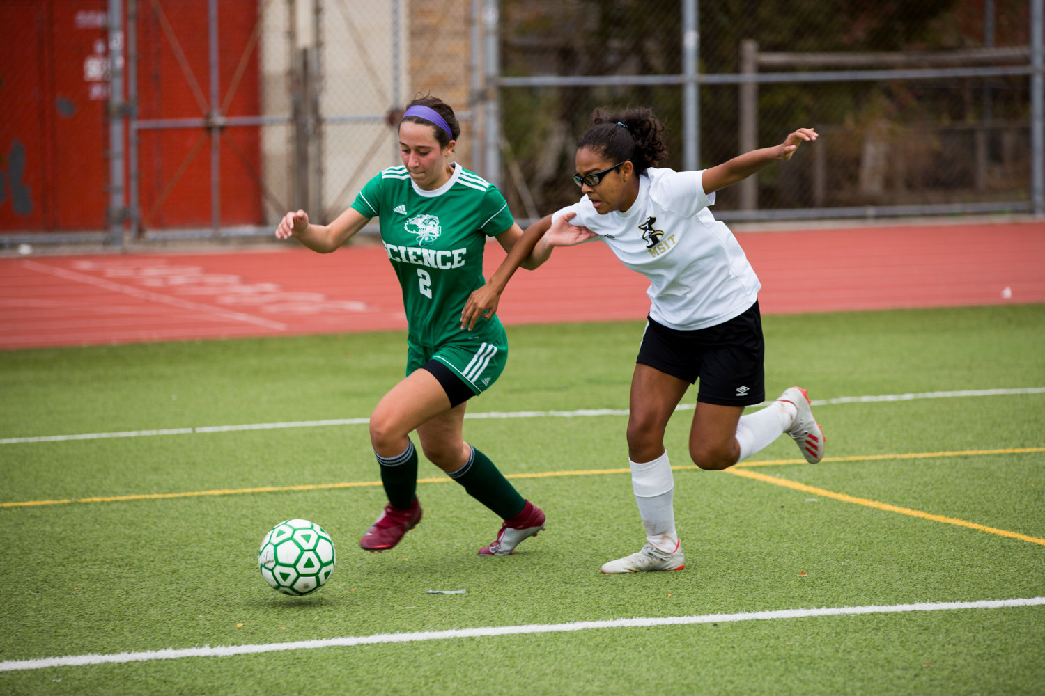 Bronx Science senior Sofia Mahairas makes her way around a McKee defender in the Wolverines' second-round playoff victory over the Seagulls.