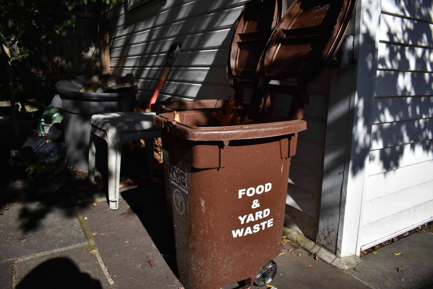 A food waste bin sits outside of Matt Turov and Debbi Dolan's home. They feel the process of composting is easy, and wish more of their neighbors did it.