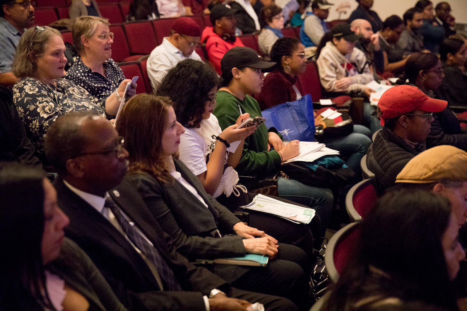 Attendees take notes during a panel discussion about the census at Lehman College on Oct. 30.