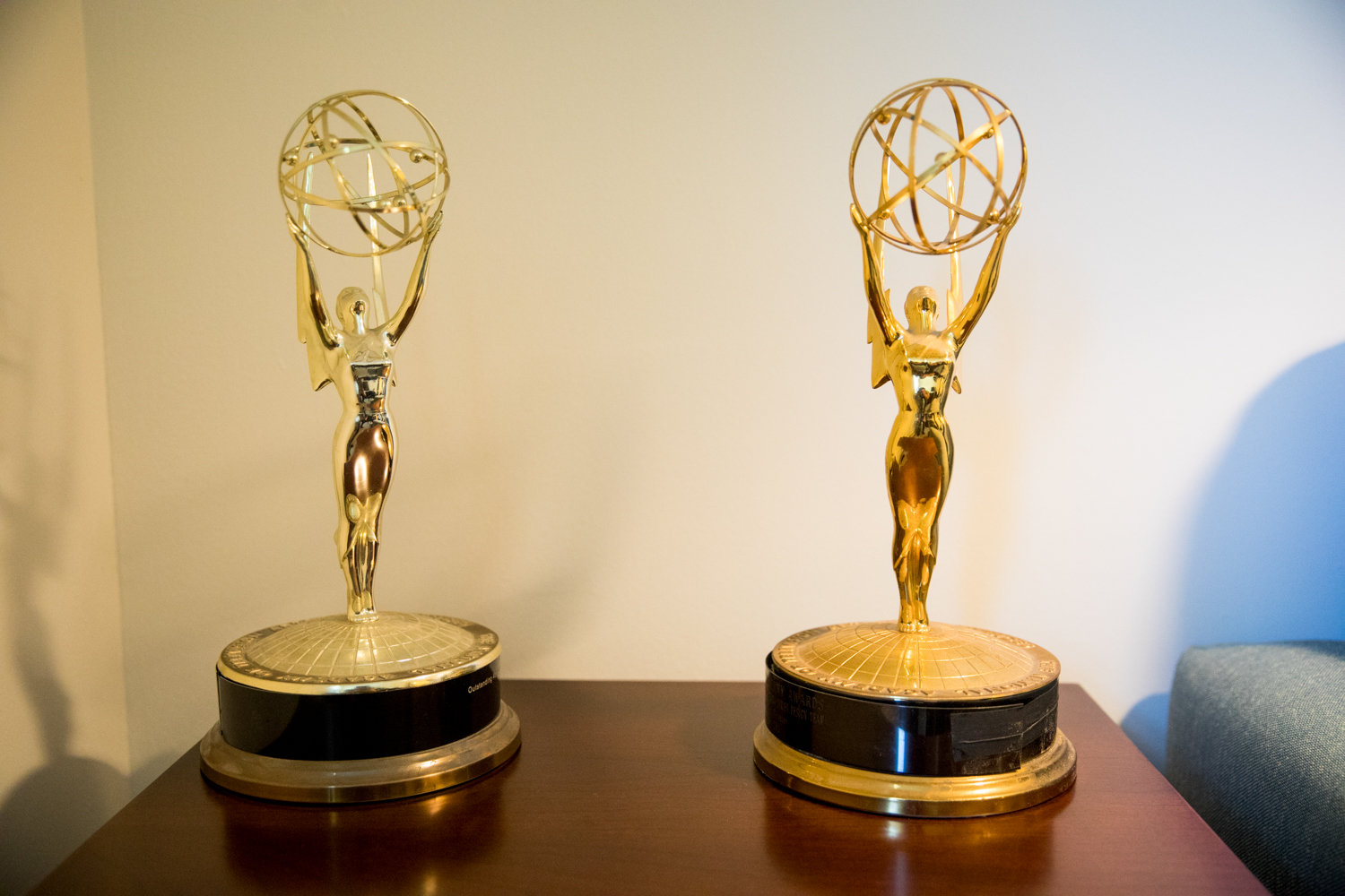 Two Emmy awards rest on Harry Miller's end table in his RiverWalk apartment. Miller won the awards during his long television career.