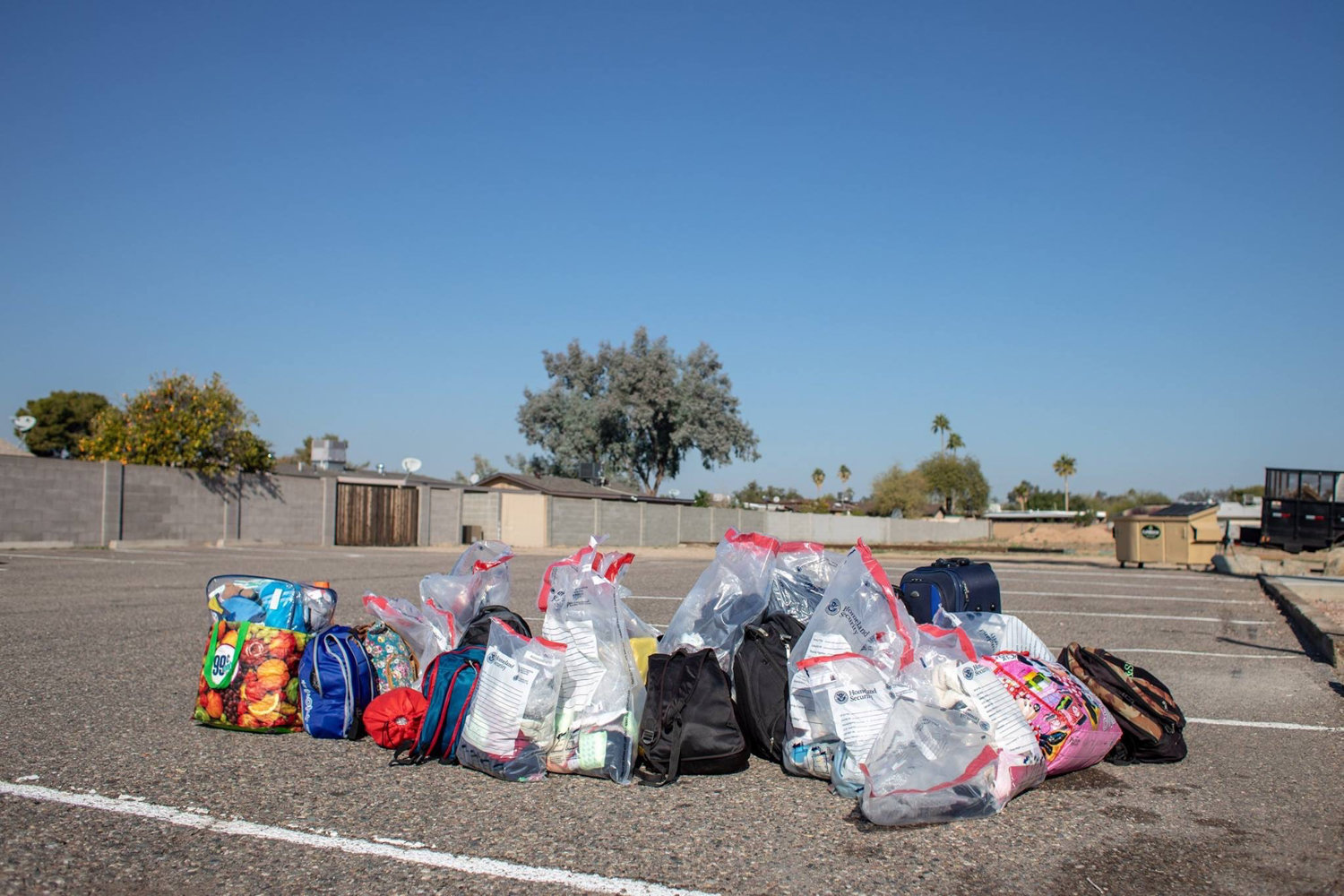 The belongings of undocumented immigrants rest on the ground during a January trip Marti Michael made to the U.S. southern border in Arizona.