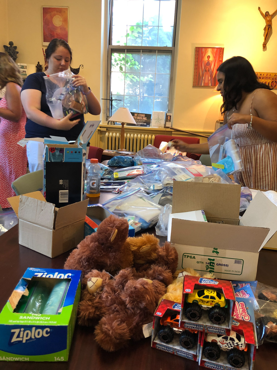 Manhattan College student Ireland Twiggs helps to prepare care packages for undocumented immigrants at the U.S. southern border in September. Thanks to the efforts of Marti Michael, Twiggs will visit the border in January.