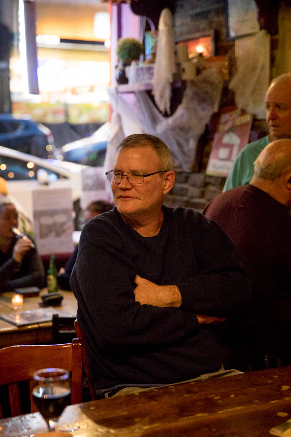 James Powers listens to Mary Courtney perform Irish music at An Beal Bocht Café on West 238th Street, where he is a regular.