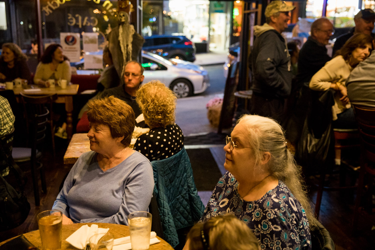 Patrons at An Beal Bocht Cafe listen to the musical stylings of Mary Courtney, a longtime regular performer at the West 238th Street establishment.