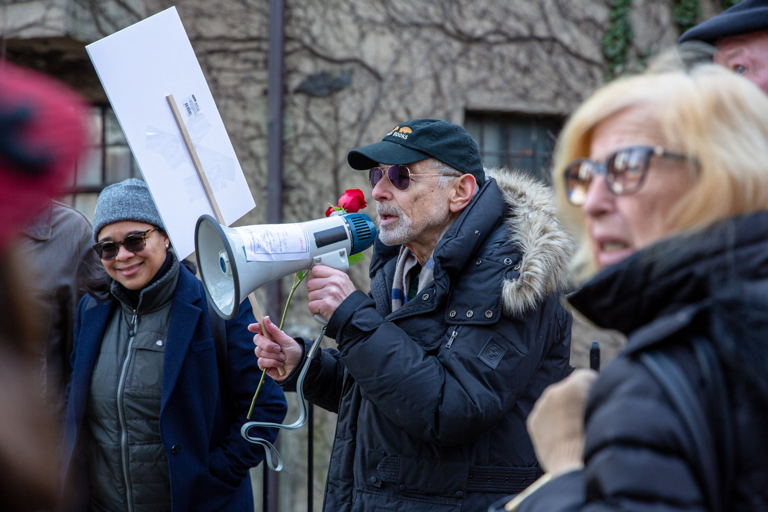 Perry Brass rallies a group of concerned neighbors in front of the sister buildings of the Villa Rosa Bonheur before leading the crowd to the threatened apartment building for a vigil in February.