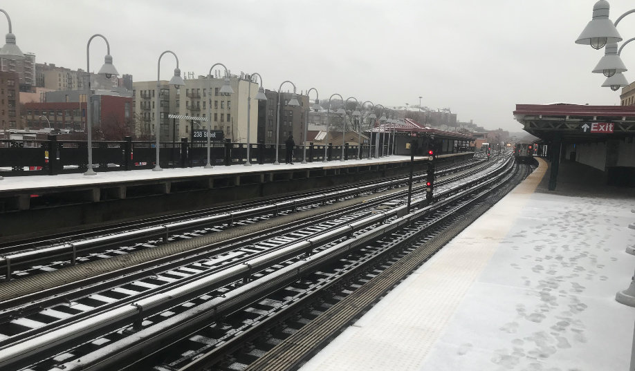 Snow and ice cover the exposed portions of the 1 train platform at West 238th Street. MTA expects there to be more slippery conditions going into Monday.