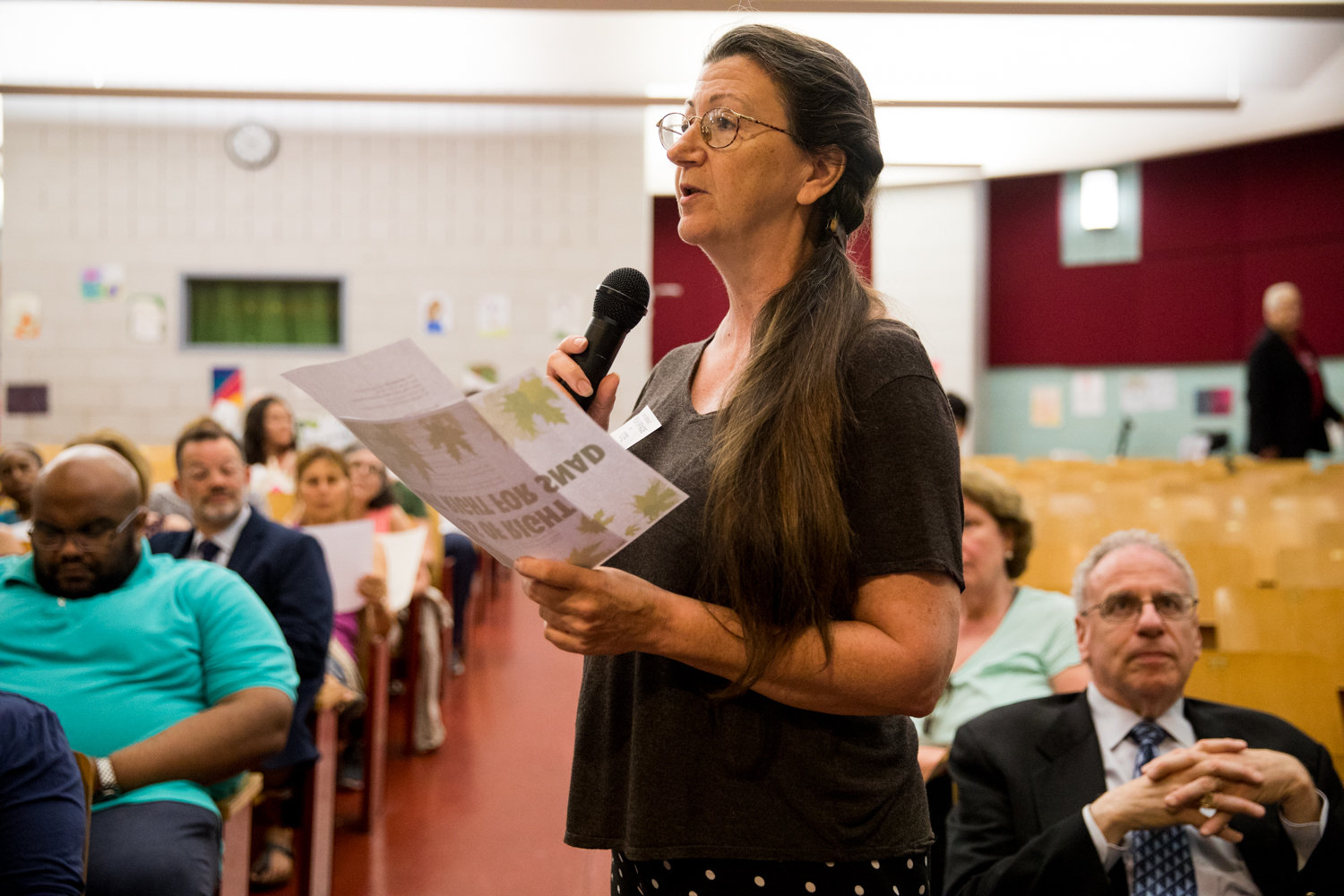 Jodie Colón, seen here at a Community Board 8 meeting last June, has been part of the grassroots effort to save the Villa Rosa Bonheur, a historic apartment building on Palisade Avenue in Spuyten Duyvil.