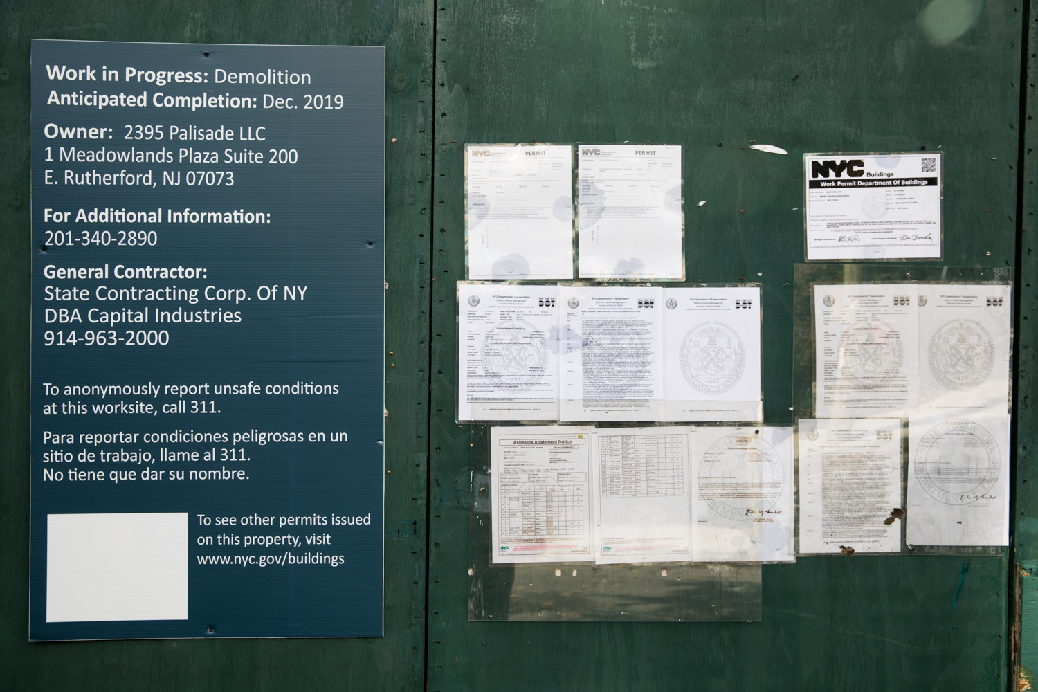 A series of work orders are pasted on a construction barrier surround the Villa Rosa Bonheur on Palisade Avenue, which has finally been authorized for demolition, despite community efforts to save the historic building.