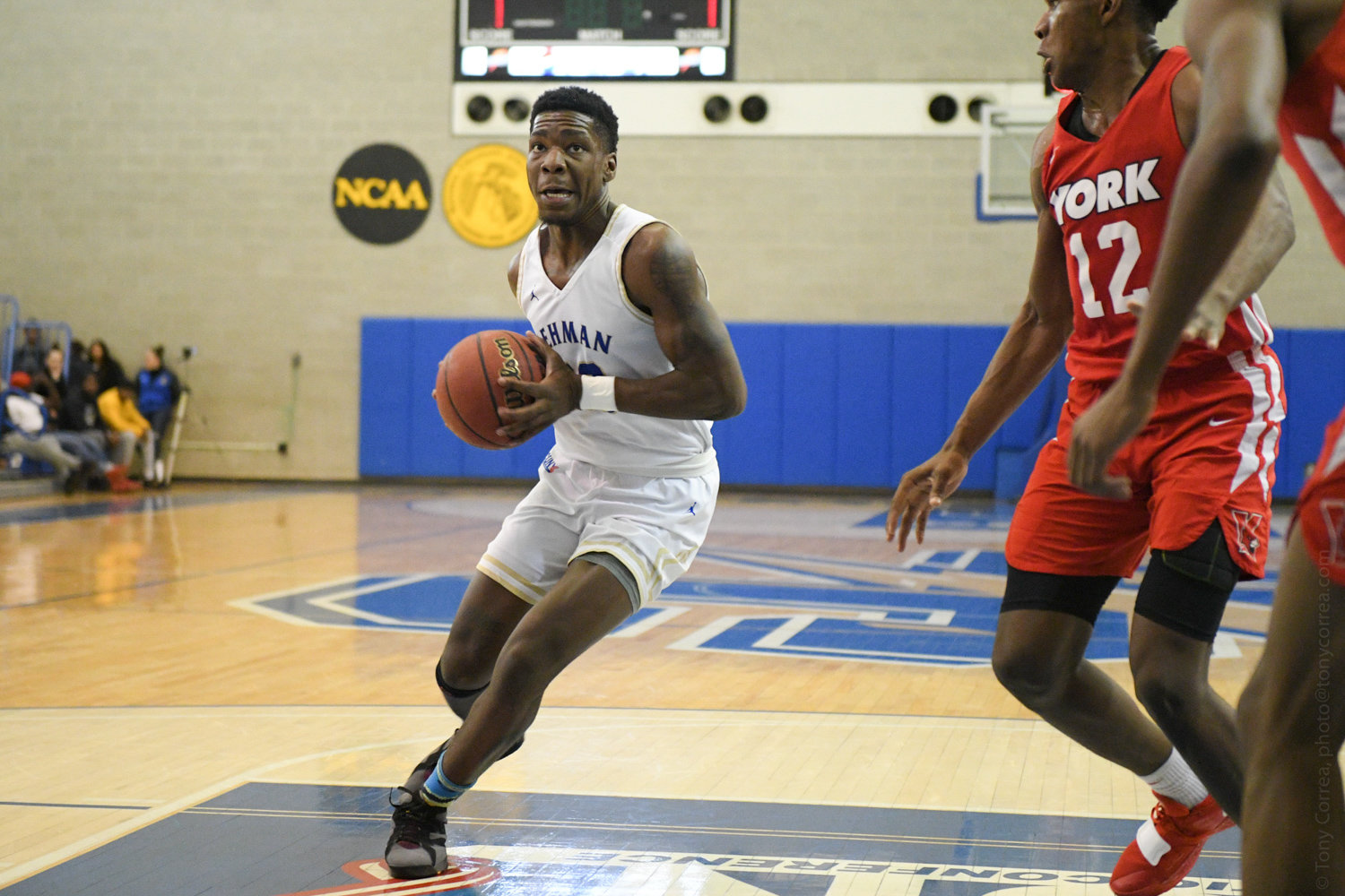 Lehman College junior guard Isaiah Geathers slices through a couple of York defenders during the Lightning's 91-64 victory last Friday night.