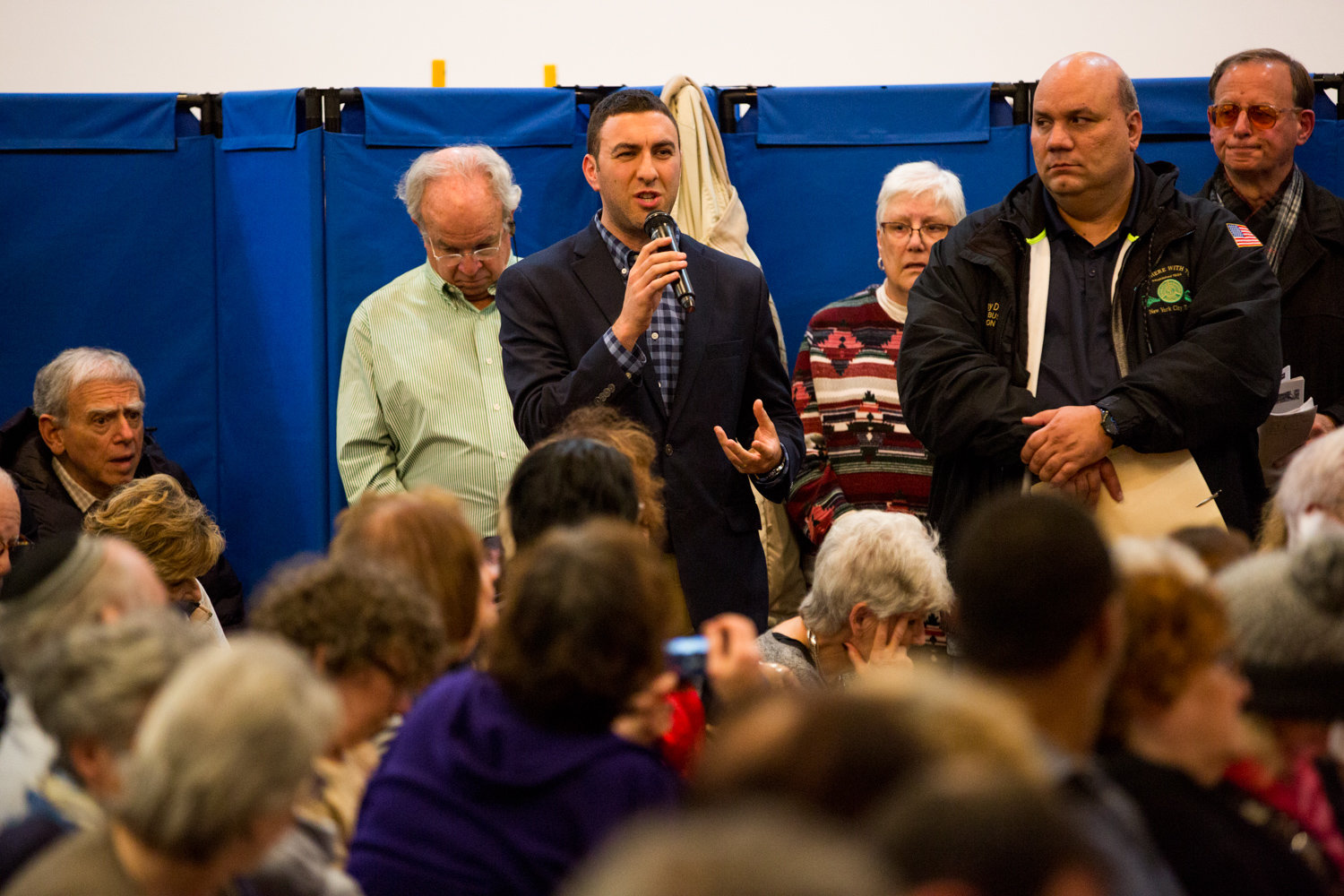 City council candidate Eric Dinowitz alleges the proposed cuts to express bus service are a form of age discrimination during a Nov. 18 community meeting with Metropolitan Transportation Authority officials organized by his father, Assemblyman Jeffrey Dinowitz.