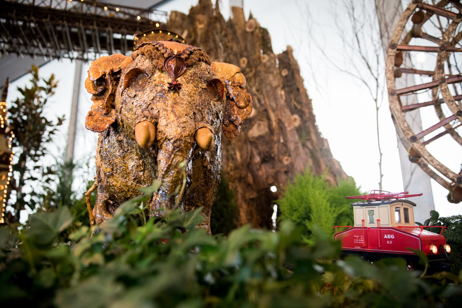 The Holiday Train Show at the New York Botanical Garden brings together different eras of New York City, including a scaled down replica of the Elephantine Colossus, a late 18th century Coney Island attraction that was destroyed in 1896.