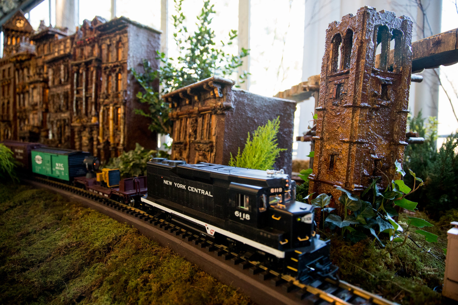A model train rolls past the Riverdale Monument in the Bronx section of the Holiday Train Show at the New York Botanical Garden.