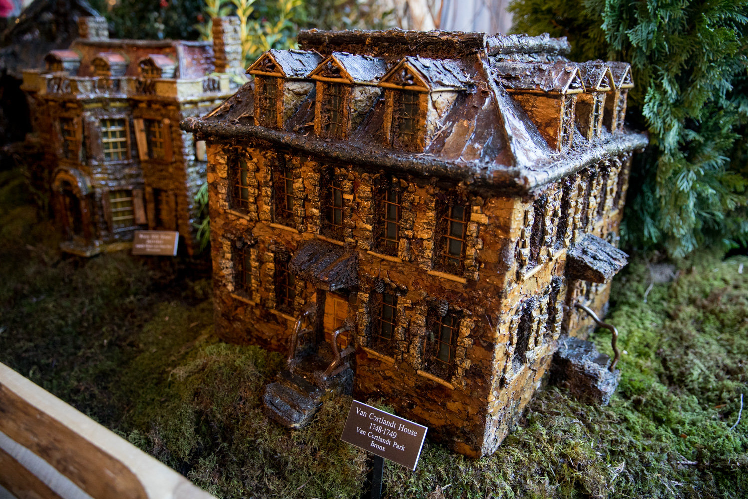 The Bronx section of the New York Botanical Garden's Holiday Train Show includes a replica of the Van Cortlandt House.