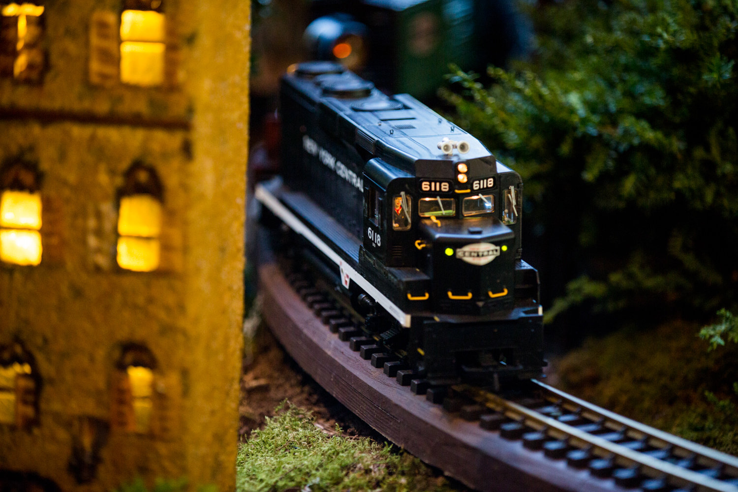 A model train rounds a bend in the Holiday Train Show at the New York Botanical Garden.
