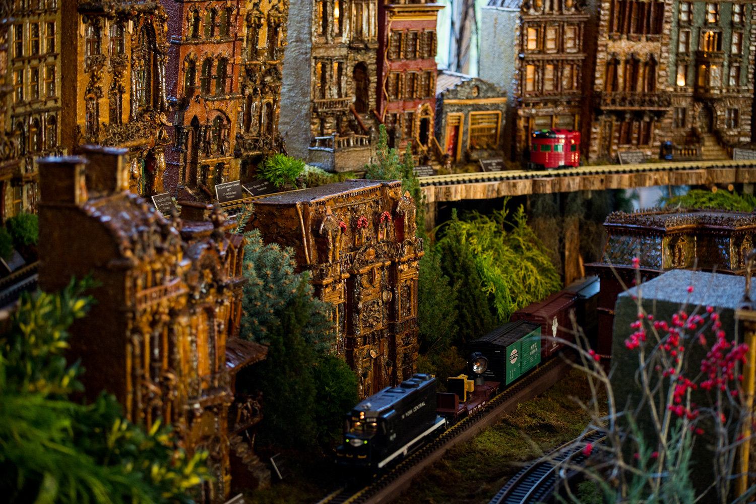 Trains wend their way through the Manhattan section of the Holiday Train Show at the New York Botanical Garden.