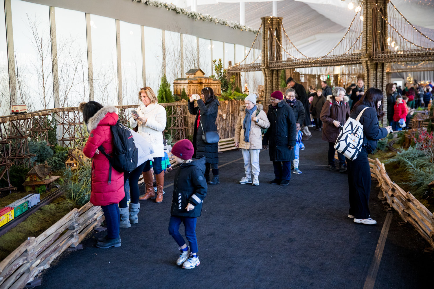 Visitors take in the Holiday Train Show at the New York Botanical Garden.