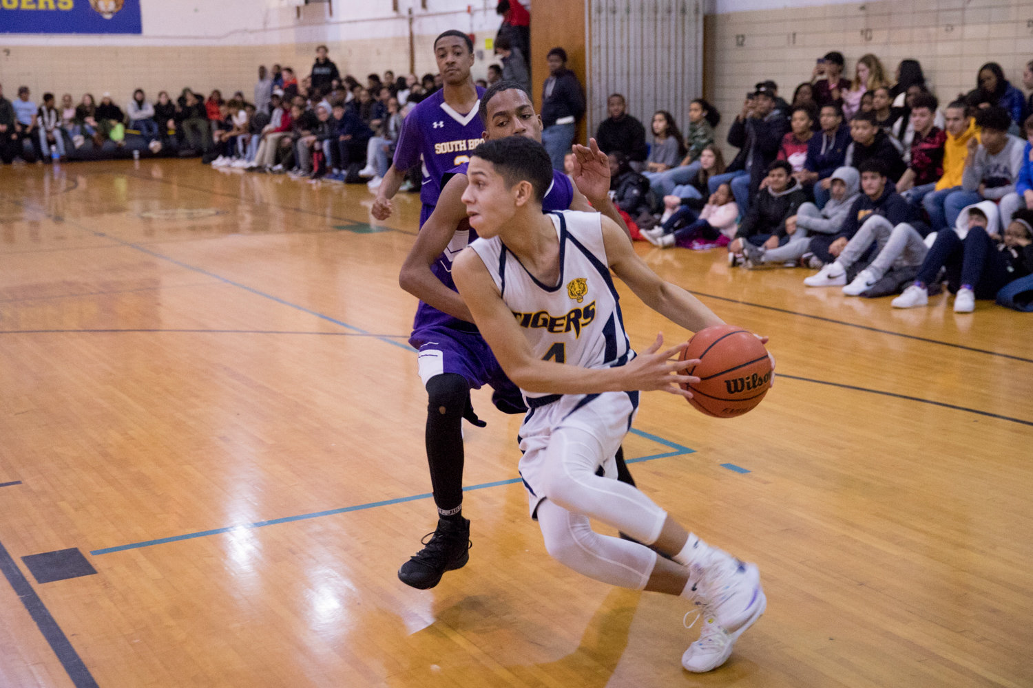 Riverdale/Kingsbridge Academy senior guard Ethan Bonet works his way around a South Bronx defender during the Tigers' loss to the Phoenix last week.
