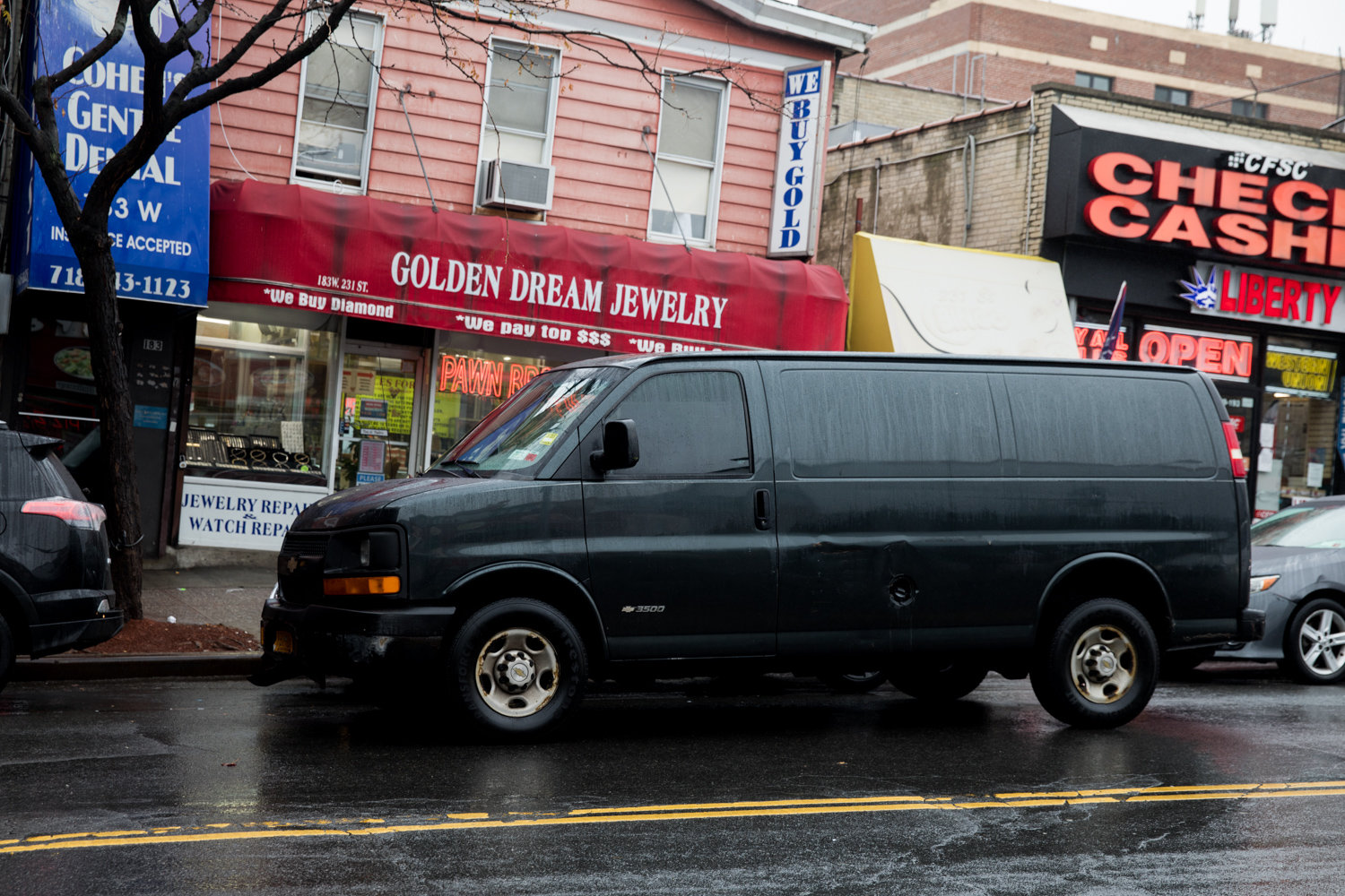 A van is double-parked on West 231st Street just off Broadway. The northwest Bronx is a hotbed of parking problems.
