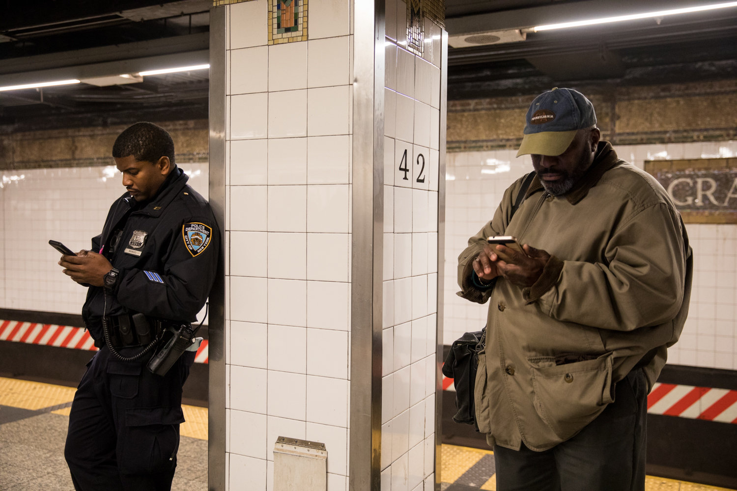 A police officer checks his phone on the platform at Grand Central 42nd Street. Assemblyman Jeffrey Dinowitz would rather see the $249 million allocated for new police officers in the subway to go toward fixing the transit system.