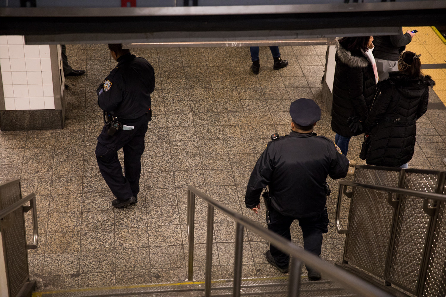 Police officers walk down to a train platform at Grand Central 42nd Street. If it were up to Assemblyman Jeffrey Dinowitz, the $250 million allocated for new police officers in the subway would go toward actually fixing the transit system.