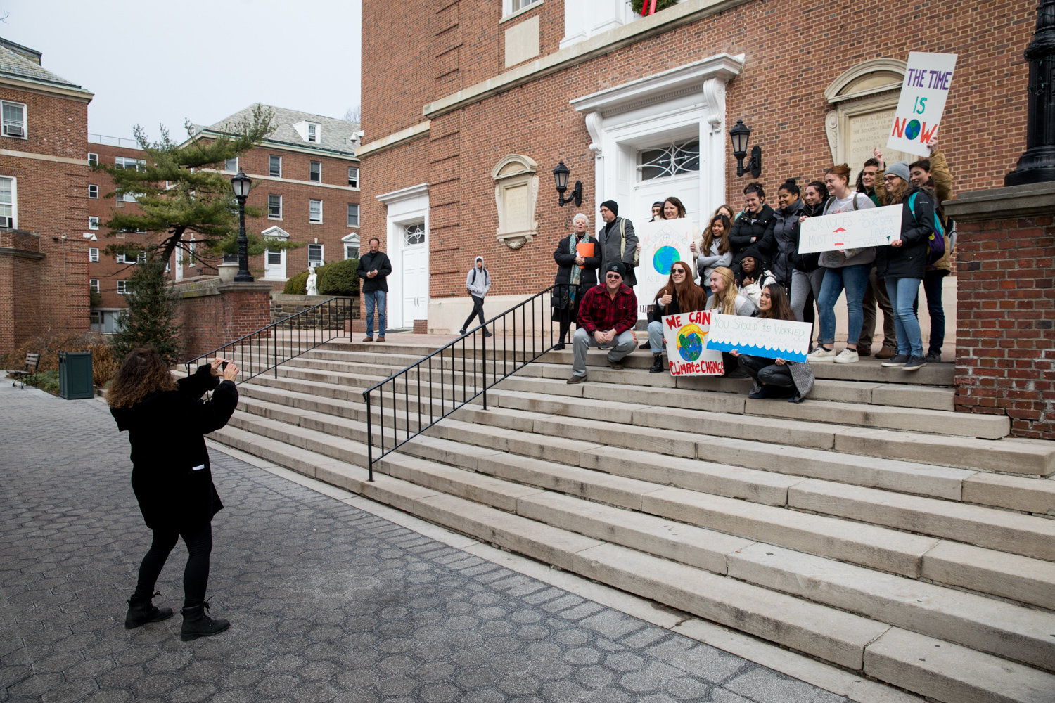 Pamela Chasek, a political science professor at Manhattan College, takes a picture of students participating in an awareness campaign calling attention to the global climate crisis inspired by Swedish climate activist Greta Thunberg's Fridays for Future movement.