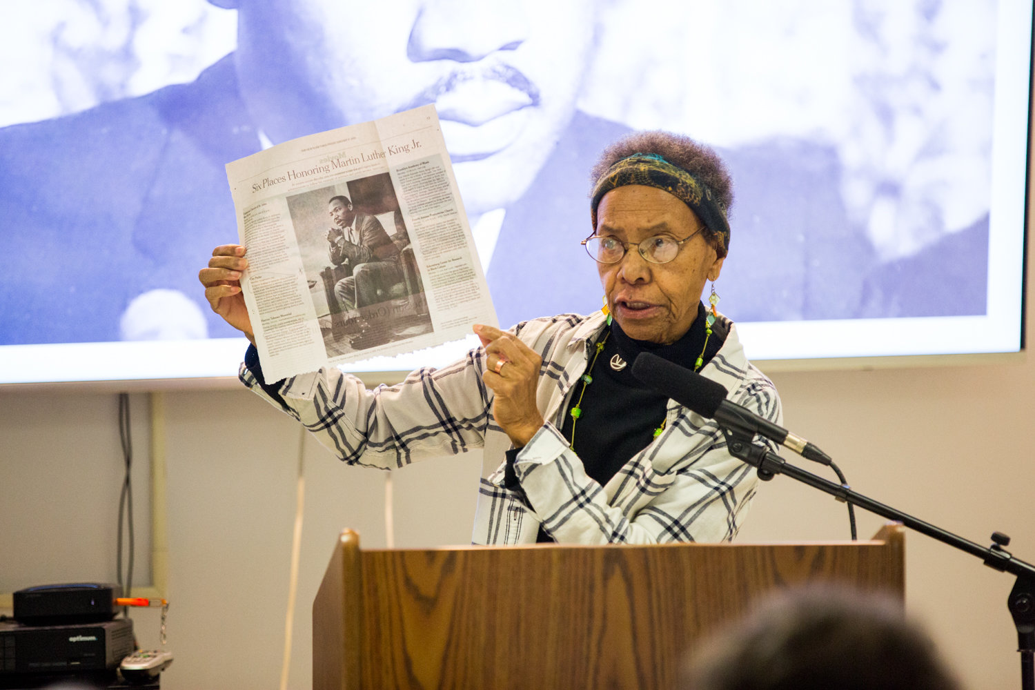 Ernece Kelly holds up a newspaper story about Dr. Martin Luther King Jr., during a presentation last week at RSS-Riverdale Senior Services. Kelly worked for King in Chicago.