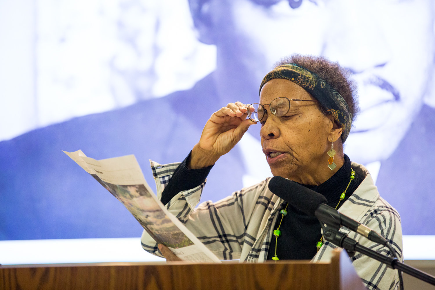 Ernece Kelly reads from a newspaper story about Dr. Martin Luther King Jr., with whom she worked for in Chicago, during a presentation about the activist's legacy at RSS-Riverdale Senior Services last week.