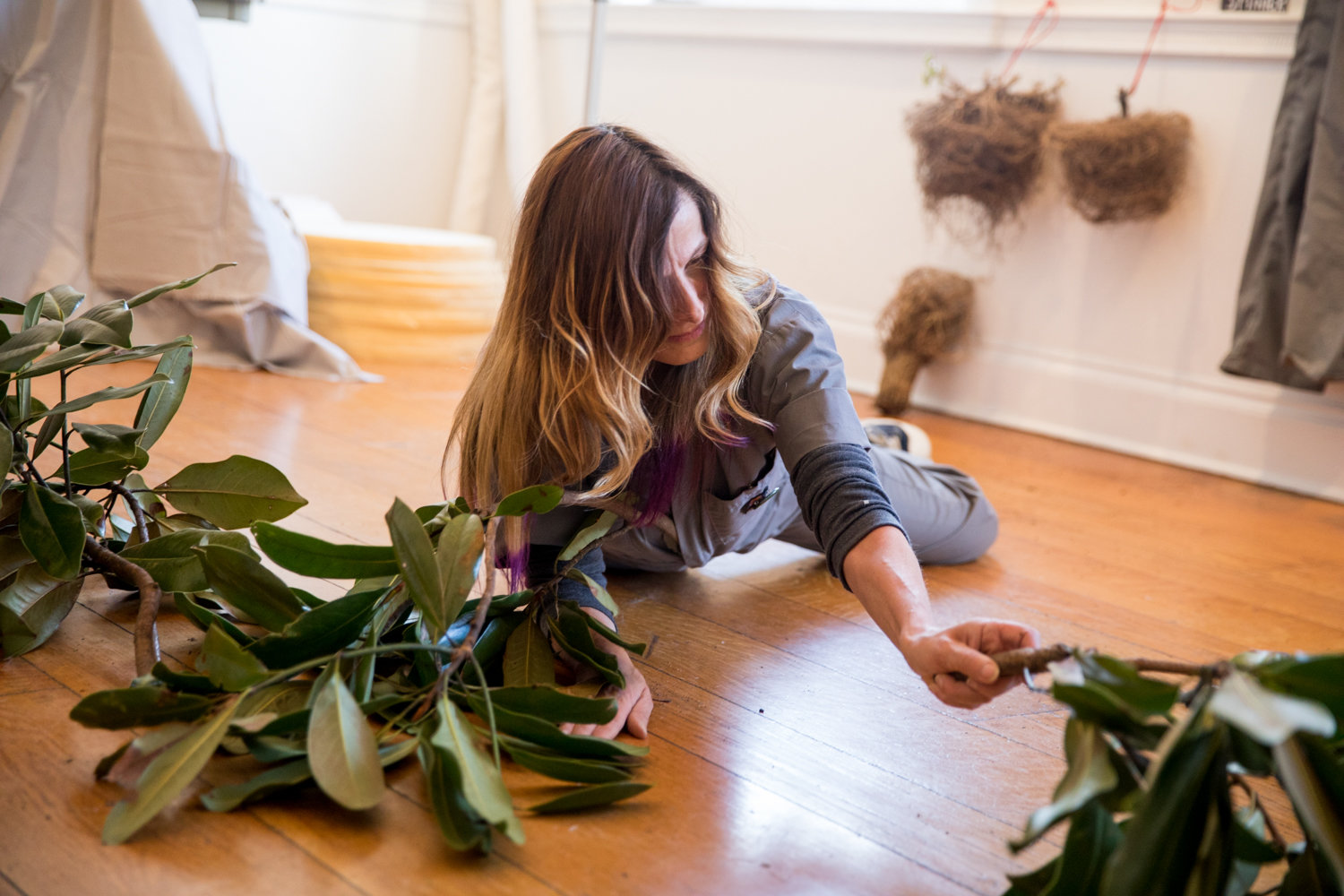 Environmental Performance Agency member Andrea Haenggi works on her performance art project for her Winter Workspace residency at Wave Hill.