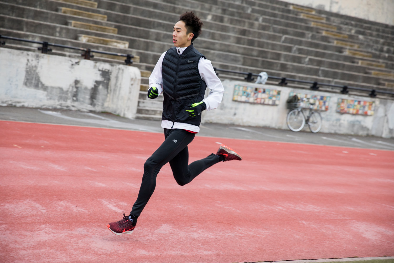 Wang Shaojie runs during a training session in Van Cortlandt Park with Manhattan College running coach Matt Centrowitz. Wang and several of his colleagues traveled to the United States to train with Centrowitz ahead of the Olympics in Tokyo.