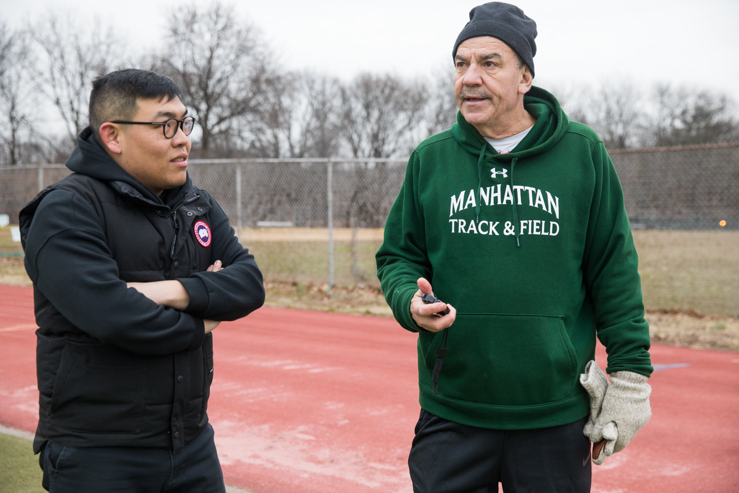 Manhattan College running coach Matt Centrowitz talks with Chinese interpreter Zhang Jiyue during a training session at Van Cortlandt Park. Zhang facilitates communication between Centrowitz and a team of Olympic runners from China.