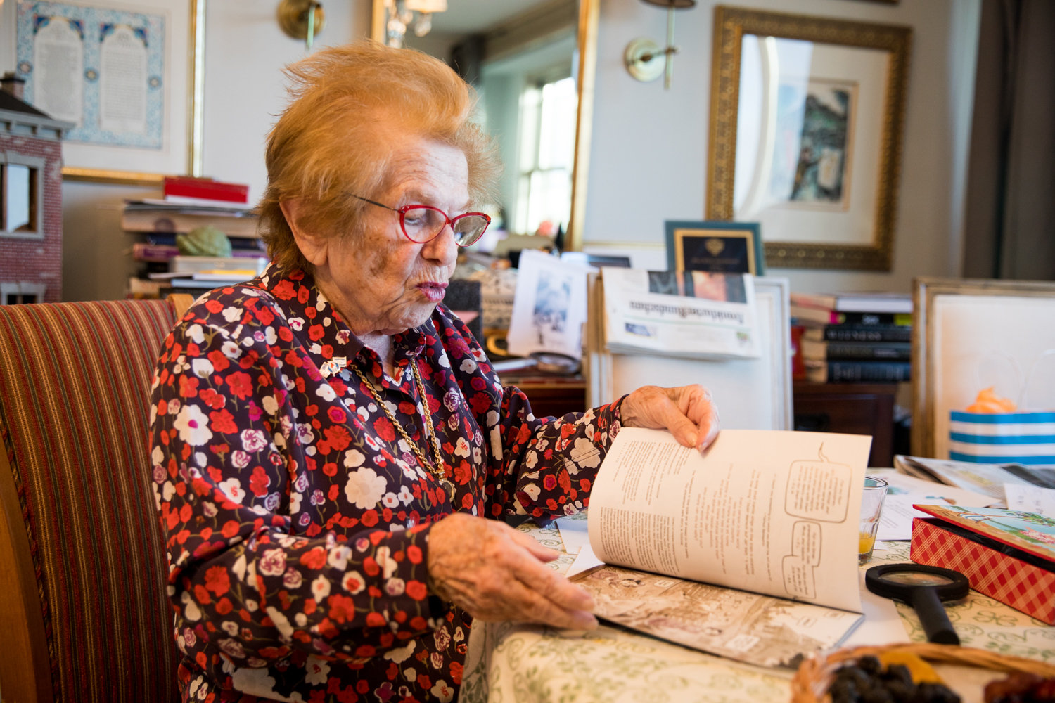 Dr. Ruth K. Westheimer flips through a graphic novel about her life's story, 'Roller Coaster Grandma: The Amazing Story of Dr. Ruth.'