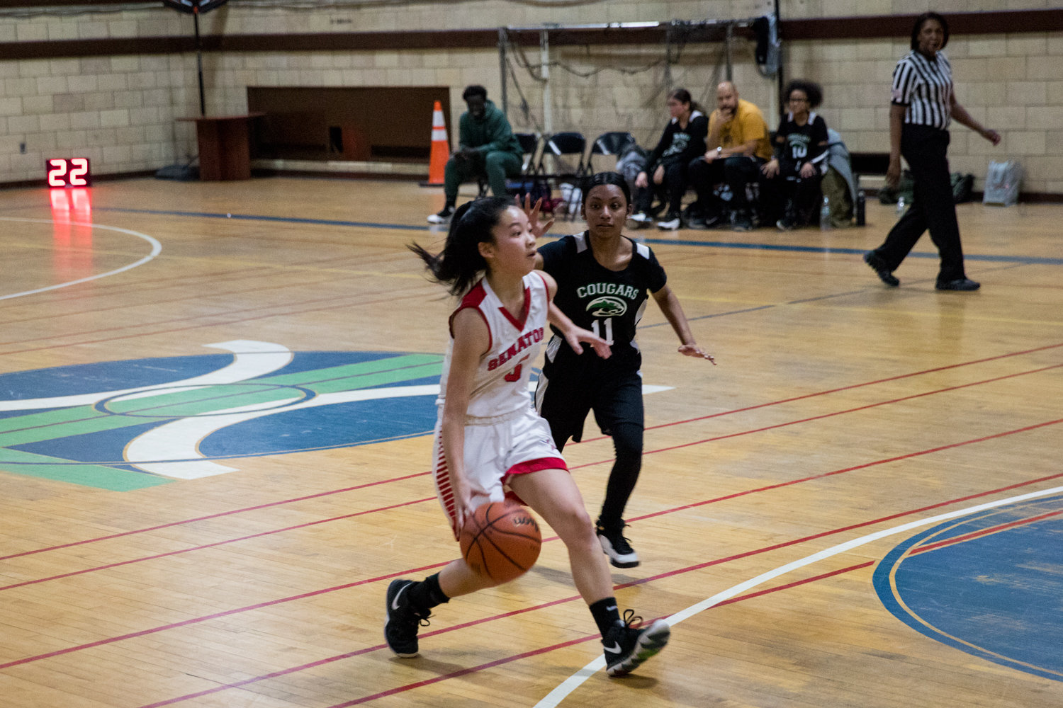 American Studies junior Zoe Cho tries to work her way around a Marie Curie defender in the Senators' 47-14 win last Friday.