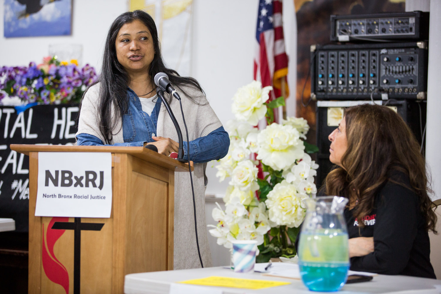 Peggy Herrera recounts a traumatizing experience she and her son had with the police during a panel discussion on mental health and police activity in communities of color at St. Stephen's United Methodist Church on Martin Luther King Jr. Day.