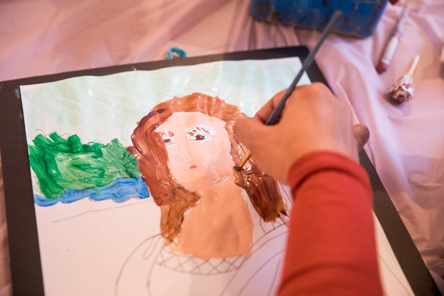 One of the goals during a recent painting workshop at Yo-Burger on Riverdale Avenue was to re-create the Mona Lisa. Children had a drawing of the painting to work from, which was provided by artist Cathy Sanacore.