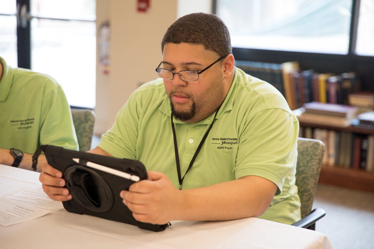 Rafael Troche works with a third generation iPad Air at the Hebrew Home at Riverdale, which recently used grant money to purchase the tablet computers for HOPE students, like Troche, to use on-site.