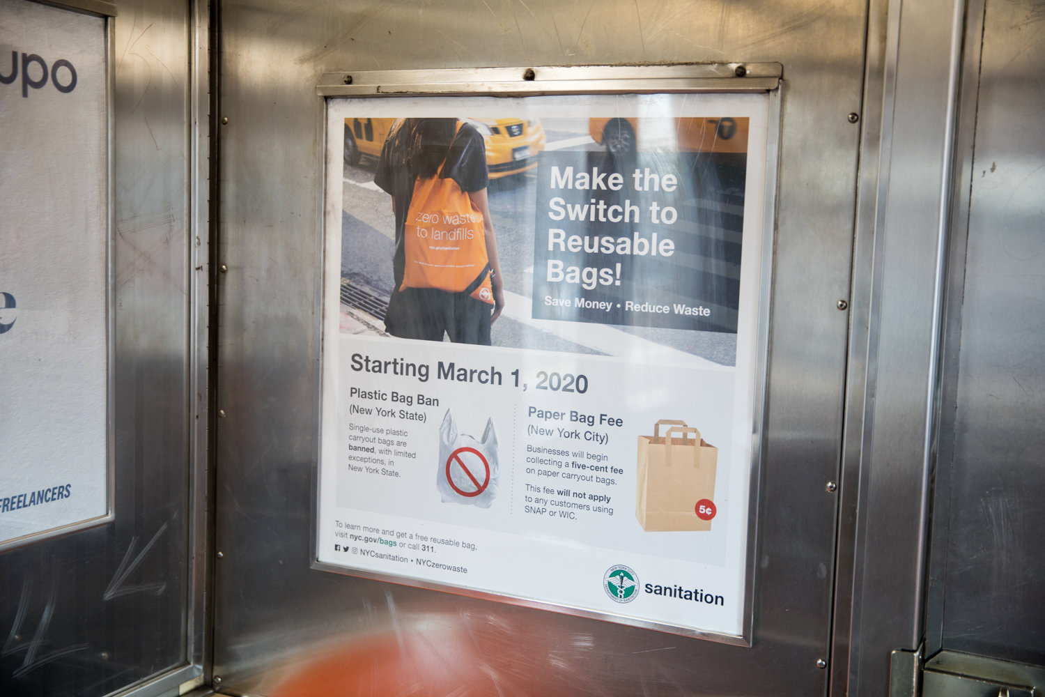 A sanitation department poster on a 1 train encourages people to make reusable bags a part of their daily lives, since plastic bags will soon be banned — with some exceptions — starting March 1.
