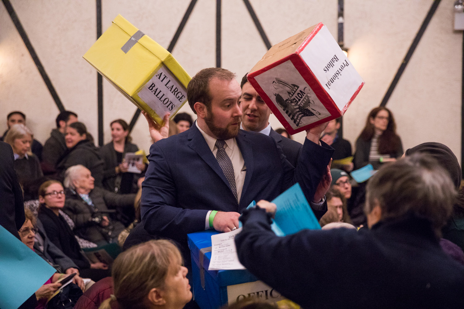 Ivan 'Duffy' Nedds, center left, and Eric Dinowitz carry ballot boxes during the Benjamin Franklin Reform Democratic Club's annual meeting Jan. 29 that saw incumbents win re-election. Both have close connections to Assemblyman Jeffrey Dinowitz — Nedds is a paid staffer in the lawmaker's district office, while Eric is his son, who also is running for city council.
