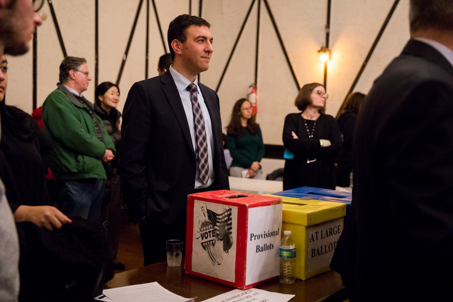 Eric Dinowitz stands near ballot boxes during the Benjamin Franklin Reform Democratic Club's annual meeting Jan. 29.