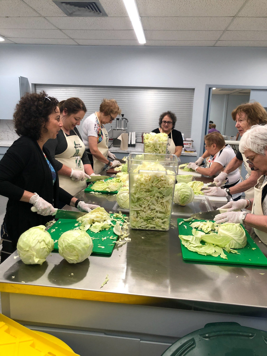 Volunteers chop lettuce to help World Central Kitchen serve food to asylum seekers in Matamoros, Mexico. The organization is providing fresh, culturally familiar food to some 1,500 people waiting for their asylum hearing with the U.S. government.