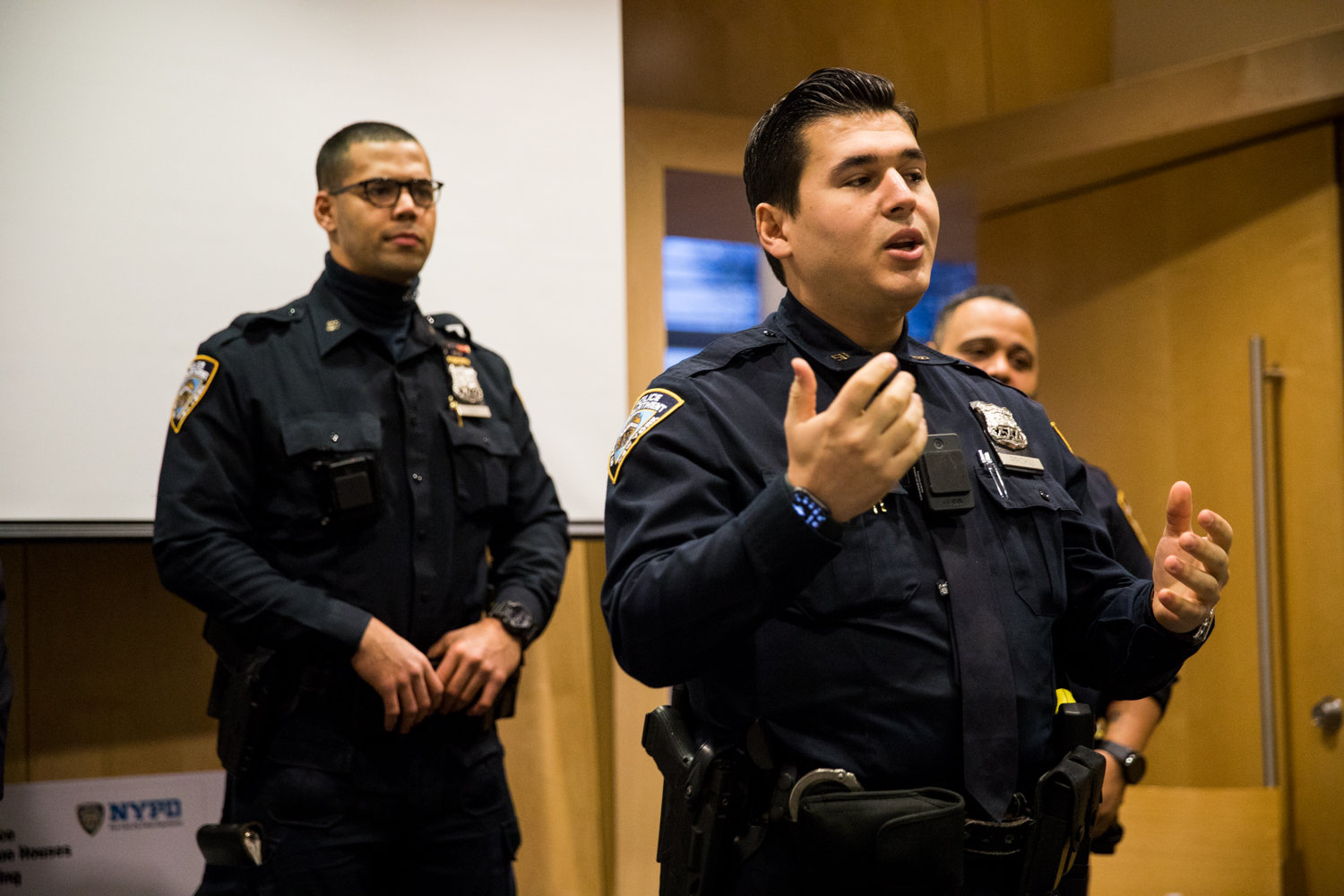 Neighborhood coordination officer Klaudio Rroku gives opening remarks at the 50th Precinct's Feb. 12 'Build the Block' meeting at the Kingsbridge Library. There, Rroku and his fellow officers sought to hear about ways to improve their neighborhoods.