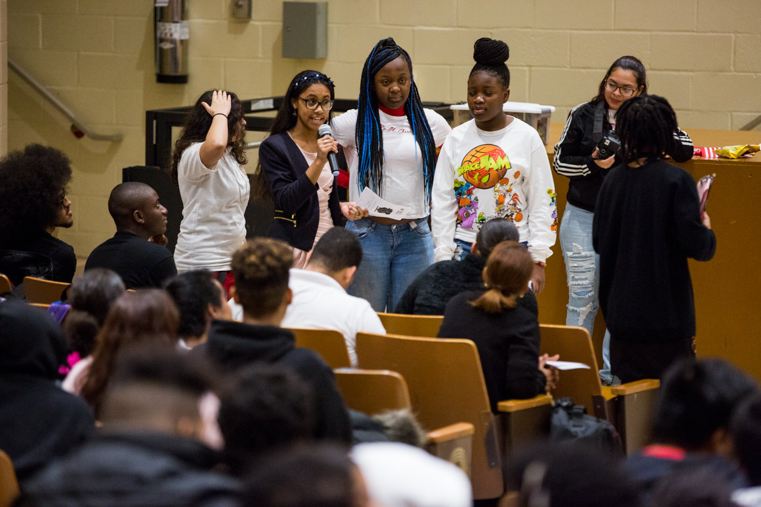 Students participate in an interactive poem for the Marble Hill School for International Studies' second annual Black History Show, organized by the school's new Black Student Union.