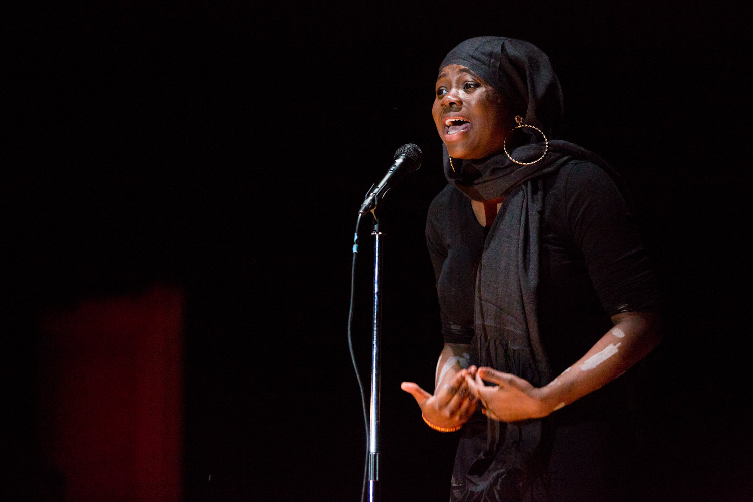 Marble Hill School for International Studies senior Hawa Camara performs an original spoken word poem, 'Racism,' for the school's second annual Black History Show.
