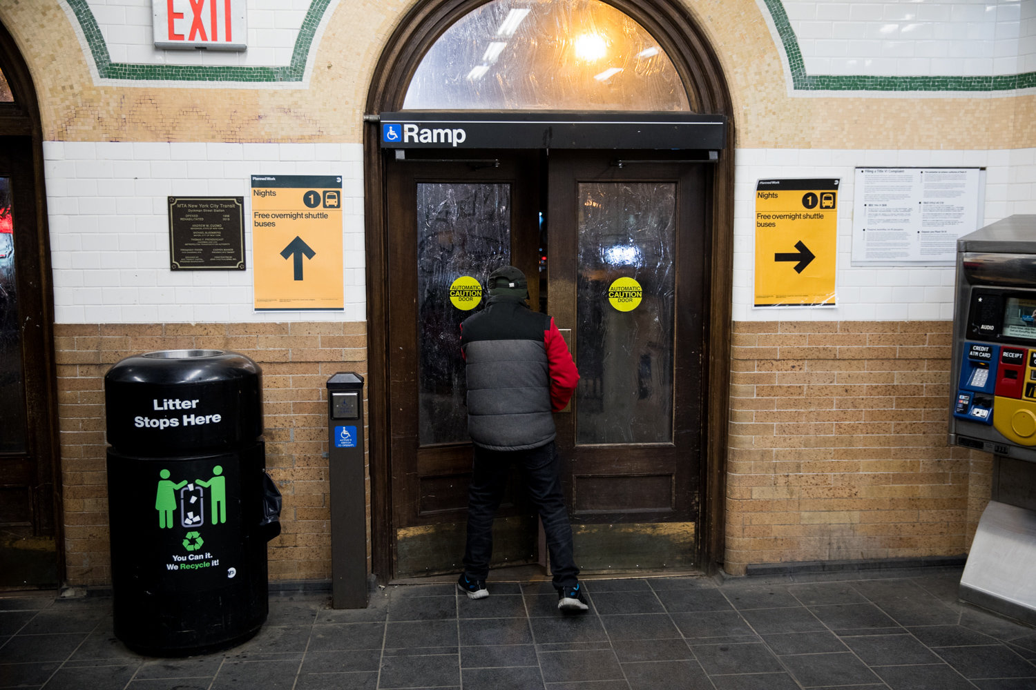 A commuter leaves the Dyckman Street 1 train station after service has been suspended between that station and 137th Street for repair work.