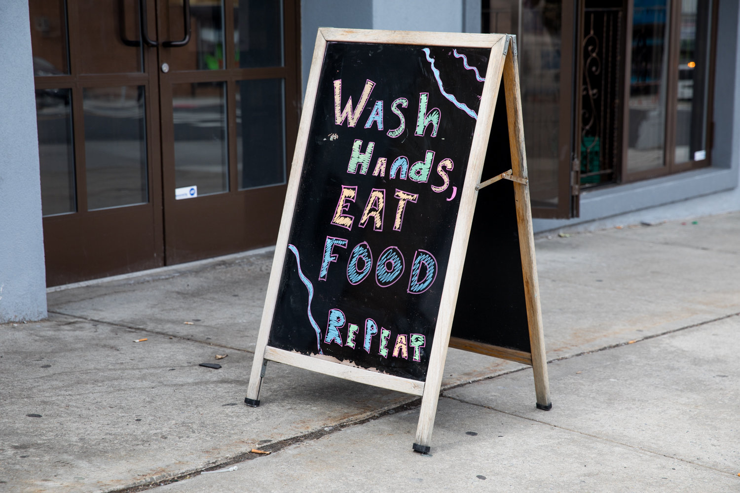 A sign outside of Ember by Smokey Joe on Riverdale Avenue urges people to wash their hands, echoing messaging by health professionals about preventative practices for the coronavirus. SAR Academy and SAR High School closed March 3 over a suspected case of the virus.
